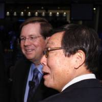 Well-connected: Yoshimi Inaba, president of Toyota Motor North America and chairman of Toyota Motor Sales U.S.A., and Jim Lentz, head of Toyota's North American sales division, attend the Detroit auto show Jan. 11. | AP PHOTO