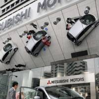 Electric buzz: Mitsubishi Motors Corp.'s i-MiEV electric vehicle is displayed at its unveiling at the automaker's Tokyo headquarters on June 5. | SATOKO KAWASAKI PHOTO