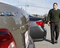 Steering clear?: Salesman Andre Kamali walks next to a Corolla at a Toyota dealership in Palo Alto, Calif., on Feb 1. | AP PHOTO