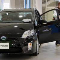 Brand new: Visitors inspect a 2010 Toyota Prius at a Toyota Motor Corp. showroom in Tokyo Thursday.   AP PHOTO
