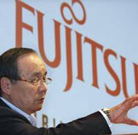Ill feelings?: Former Fujitsu Ltd. President Kuniaki Nozoe, who is embroiled in a dispute with the computer maker over his exit from the top post, faces reporters in Tokyo in July. | BLOOMBERG