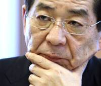 Strategizing: Yoshito Sengoku, minister for national strategy, listens during an interview Friday in Tokyo. | BLOOMBERG