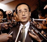 And your question is?: Bank of Japan Gov. Masaaki Shirakawa faces reporters Friday after a meeting with Prime Minister Yukio Hatoyama at the latter's official residence in Tokyo.   KYODO PHOTO