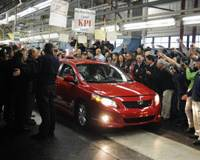 And then there were none: The last Toyota Corolla produced at New United Motor Manufacturing Inc. in Fremont, Calif., is surrounded by factory workers Thursday. | KYODO / NUMMI PHOTO
