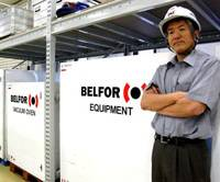 Prepared: Koji Toritani, president of Belfor Japan, stands near equipment boxes in a storage facility in Edogawa Ward, Tokyo. The company brings such boxes, which contain business recovery tools, to disaster sites. | KAZUAKI NAGATA PHOTO