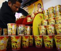 Hungry?: Cups of instant noodles made by Nestle Malaysia are arranged for display at the World Instant Noodle Summit in Kuala Lumpur on Wednesday. | AP PHOTO