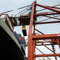 On the rise: A container is loaded onto a Nippon Yusen K.K. ship at a terminal in Tokyo in September 2008. | BLOOMBERG