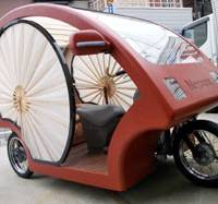 Very Japanese?: This three-seat, three-wheeled electric vehicle was developed by a group of companies in the Kansai region. | KYODO PHOTO