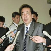 Crisis mode: Finance Minister Naoto Kan speaks to reporters at the ministry Monday after the Group of Seven issued a joint statement on the Greek financial crisis. | KYODO PHOTO