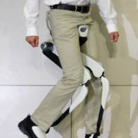 Feat of engineering: A man demonstrates a Honda Motor Co. device to aid walking at the firm's headquarters in Minato Ward, Tokyo, in November 2008.   KYODO PHOTO