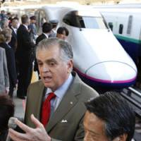 Keeping track: U.S. Transportation Secretary Ray LaHood, accompanied by JR East President Satoshi Seino, speaks to reporters during a visit to observe bullet train operations at Tokyo Station on Wednesday. | AP PHOTO