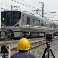 Safer design: West Japan Railway's Series 225 train is shown to the media Monday morning at a rail yard in Higashiosaka, Osaka Prefecture. | KYODO PHOTO