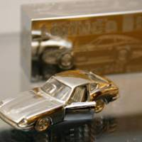 Money-guzzler: A ¥7 million platinum toy car produced by Tanaka Kikinzoku Jewelry K.K. is displayed at its Sendai outlet Wednesday, but is not for sale. | KYODO PHOTO