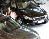 Booming business: A customer checks what's on offer at a Guangzhou Honda dealership in Shenzhen, China, on Nov. 9.   BLOOMBERG