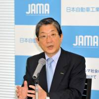 In the driver's seat: Toshiyuki Shiga, new chairman of the Japan Automobile Manufacturers Association, is interviewed Friday at Nissan Motor Co.'s headquarters in Yokohama. | YOSHIAKI MIURA PHOTO