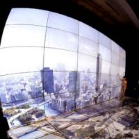 Razor thin: A new multiscreen display system with what is touted as the world's thinnest frame width is unveiled by Sharp Corp. in Tokyo's Akasaka district Monday.   KYODO PHOTO