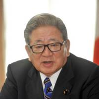 Tax foe: Shozaburo Jimi, new financial services and postal reform minister, is interviewed at the Financial Services Agency on Tuesday. | YOSHIAKI MIURA PHOTO