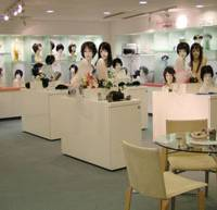 Going upmarket: Aderans Co.'s wigs are displayed at one of the company's showrooms in Tokyo recently.   BLOOMBERG