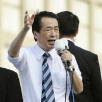 On the line: Prime Minister Naoto Kan speaks to voters in Shinjuku Ward, Tokyo, on June 12. | KYODO PHOTO