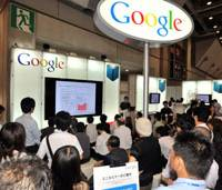 The old-fashioned way: People gather at Google Inc.'s booth to learn about Google Books at the 17th Tokyo International Book Fair at Tokyo Big Sight on Thursday. | YOSHIAKI MIURA PHOTO