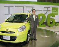 Foreign made: Nissan Motor Co. CEO Toshiyuki Shiga shows off a March compact car imported from Thailand. | KYODO PHOTO