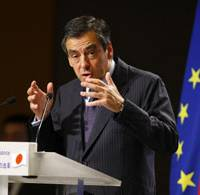 Upbeat message: French Prime Minister Francois Fillon speaks before Japanese business leaders Friday in Tokyo during his two-day visit to Japan. | AP PHOTO