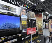 New 3-D force: Sharp Corp.'s Aquos Quatron 3D TV LV series are on display at a Yodobashi Camera store in Osaka's Umeda district Thursday.   KYODO PHOTO
