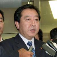 Staying on message: Finance Minister Yoshihiko Noda speaks to reporters in Tokyo on Aug. 12. | KYODO PHOTO