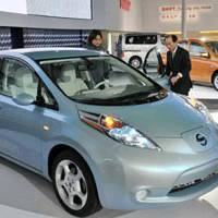 Leaf of faith: Nissan Motor Co.'s Leaf electric car is displayed at the Beijing Motor Show in April. Orders for the car are increasing from taxi operators. | KYODO PHOTO