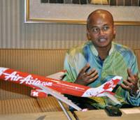 High aspirations: Azran Osman-Rani, chief executive officer of AirAsia X, is interviewed in Tokyo on Tuesday. | KYODO PHOTO