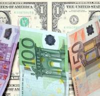 Pose for effect: Dollars and euros are arranged for a photograph in Frankfurt on Aug. 9.   BLOOMBERG PHOTO