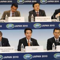 Man of the moment: Foreign Minister Seiji Maehara (front center), who with Economy, Trade and Industry Minister Akihiro Ohata (front right) cochaired a meeting of foreign and trade ministers from the Asia-Pacific Economic Cooperation forum, speaks during a joint news conference in Yokohama on Thursday. | KYODO PHOTO