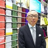 Basic message: Fast Retailing Co. President Tadashi Yanai poses for a portrait at the opening ceremony for a Uniqlo store in Osaka on Oct. 1. | BLOOMBERG PHOTO