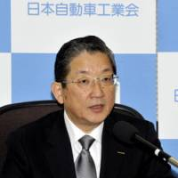 Car talk: Toshiyuki Shiga, chairman of the Japan Automobile Manufacturers Association and chief operating officer of Nissan Motor Co., is interviewed Wednesday in Tokyo. | YOSHIAKI MIURA PHOTO
