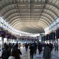 On message: People passing through Tokyo's Shinagawa Station in November view ads on 44 digital displays, each measuring 65 inches, installed in the concourse. | EAST JAPAN MARKETING AND COMMUNICATION