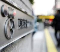 Stonewalling: A man walks past Tokyo Electric Power Co.'s headquarters in Tokyo last week. | BLOOMBERG