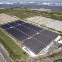 Solely solar: Dubbed a 'mega solar' plant, Kansai Electric Power Co.'s commercial power station in Sakai, Osaka Prefecture, generates electricity entirely by solar panels. | KYODO PHOTO