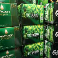 This suds for you: Haagen, Turborg and Carlsberg brews by Independent Liquor line the shelves in a liquor store in Auckland. Independent Liquor has been brought by Asahi Holdings.   BLOOMBERG
