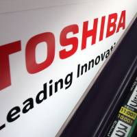 Buyout: Toshiba Corp.'s logo is displayed at an electronics store in Tokyo on May 9.   BLOOMBERG