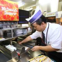 McChef: An employee works at McDonald's Japan research and development test kitchen in Tokyo on Oct. 3, 2007.   BLOOMBERG PHOTO