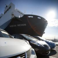 Market-ready: Nissan Motor Co. cars sit dockside at the Port of Los Angeles in Wilmington, California, after being offloaded Monday. | BLOOMBERG