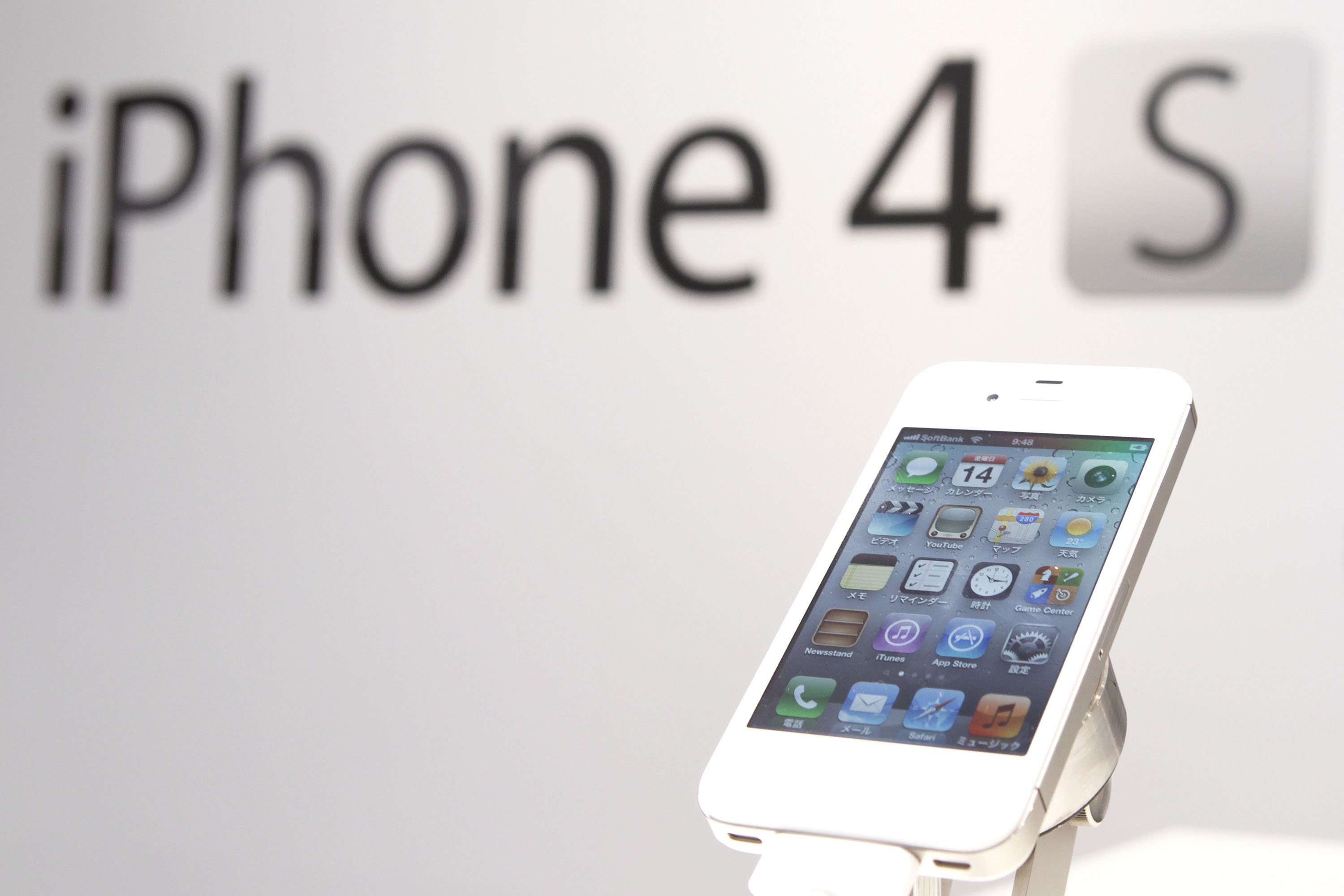 Just in: Apple Inc.'s iPhone 4S smartphone is displayed at SoftBank Corp.'s flagship store in Tokyo on Friday after the new handset went on sale. | BLOOMBERG PHOTO