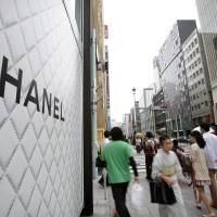 Shopping spree: Luxury boutiques such as Chanel and Bulgari line Tokyo's upscale Ginza shopping district.   BLOOMBERG