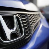 Mark of quality: Honda Motor Co.'s logo adorns the front of a vehicle at the company's headquarters in Tokyo in June.   KYODO