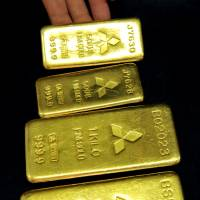 Glittering future: Gold bars weighing 500 grams and 1 kg are arranged at a Mitsubishi Material Corp. shop in Tokyo in August.   BLOOMBERG PHOTO