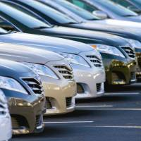 Take one for a spin: 2011 Camry sedans are displayed at the Fred Anderson Toyota dealership in Raleigh, North Carolina, in February.   BLOOMBERG PHOTO