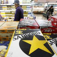 Rising star: Cases of beer made by Sapporo Breweries Ltd. are displayed with other types of beer at a supermarket in Soka, Saitama Prefecture, in February. | BLOOMBERG PHOTO