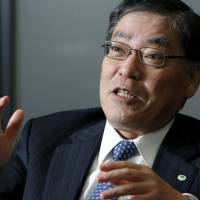 Michijiro Kikawa, president and chief executive officer of Hitachi Construction Machinery Co., speaks at an interview on Dec. 22. | BLOOMBERG PHOTO