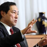 Looking abroad: Yasuhiro Sato, president and chief executive officer of Mizuho Financial Group Inc., speaks during an interview in Tokyo on Dec. 6.   BLOOMBERG PHOTO