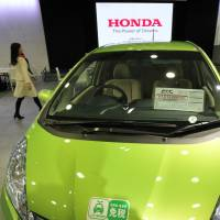 High hopes: Honda Motor Co.'s Fit hybrid vehicle is displayed at the company's headquarters in Tokyo on Tuesday. | BLOOMBERG